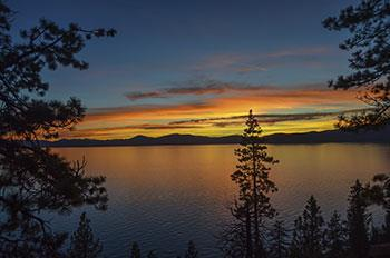 Enjoy beautiful sunsets over Lake Tahoe after working with a real estate agent Incline Village, NV